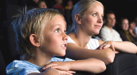 Mum and son watch a children's musical